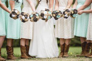 closeup shot bride bridesmaids holding flowers