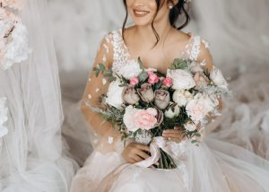luxury bride holding big bouquet flowers